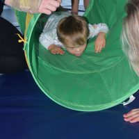 Boy during respite care in green tunnel